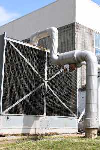 Image of an industrial cooling tower for an office building